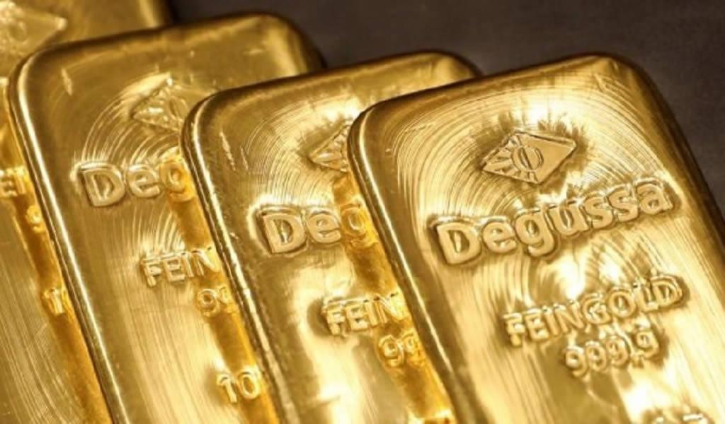 Oro cae a mínimo de una semana por avance del dólar mientras que atención se centra en la FED