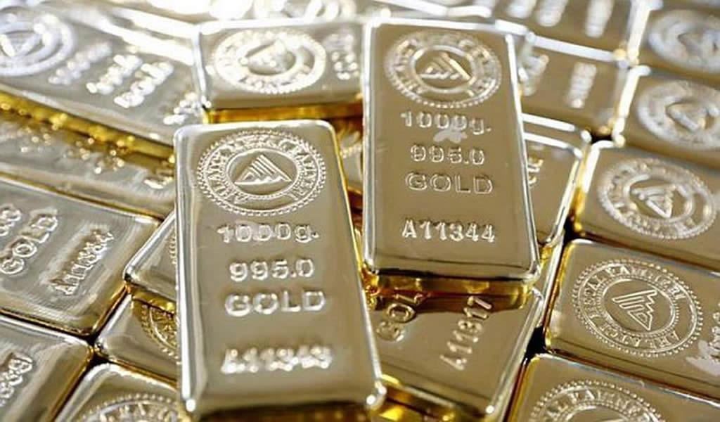 Oro cae lastrado por apreciación del dólar y datos industriales positivos en China